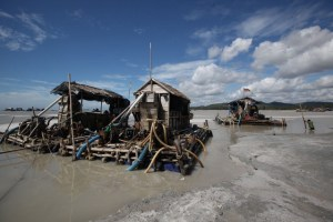 A photograph of a few of the floating pontoons used for tin mining in Bangka, Indonesia.