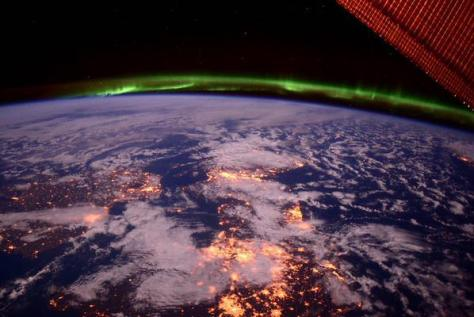 A photograph taken from the International Space Station and showing the northern lights $ ($aurora borealis$ )$ above Scotland.