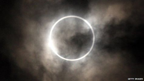 "A photograph of the total eclipse seen from Tokyo in 2012, featuring the Sun's corona and the famous ""diamond ring""."