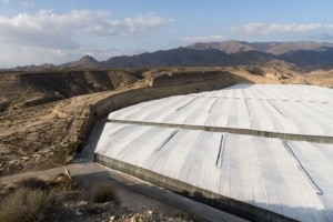 A photograph showing the ever spreading Almeria greenhouses, now reaching up to the mountains of the Sierra de Gádor.