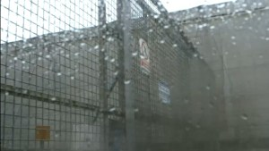 A still photograph taken from a Channel Four documentary showing the forbidding security gates at El Ejido, in Spain.