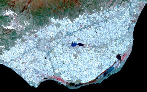 """A satellite photograph of El Ejido """"Plastic City"""" in southern Spain, showing the vast expanse of the plastic covered greenhouses near Almeria."""
