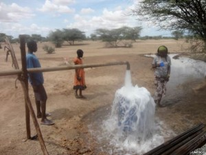A photograph showing how a solar powered water pump has become a lifeline for the village of Napuu in Kenya.