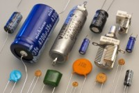 A photograph showing a whole range of different capacitors.