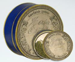A photograph of a museum exhibit: a tin can containing medical-grade cannabis, dating from 1925.