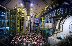 The ensemble of the personnel from the LHCb Collaboration posing in front of one of the sections of the Large Hadron Collider, at CERN on the Franco-Swiss border.