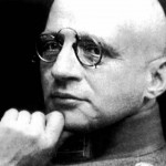 A black and white photograph of Fritz Haber with his trademark pince-nez glasses.