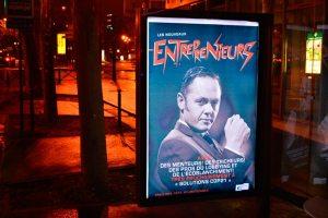 """A fake cinema poster for the movie: """"Les Nouveaux Entreprenieurs"""" $ ($The New Entrepre-deniers$ )$. The caption reads: """"Avec Des Menteurs, Des Tricheurs, Des Pros du Lobbying et de l'Écoblanchiment! Très prochainement à Solutions COP21"""" $ ($Featuring Liars, Cheats, Pros of Eco-Lobbying Coming soon to Solutions COP21$ )$."""