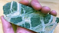 A photograph showing a slab of serpentinite.