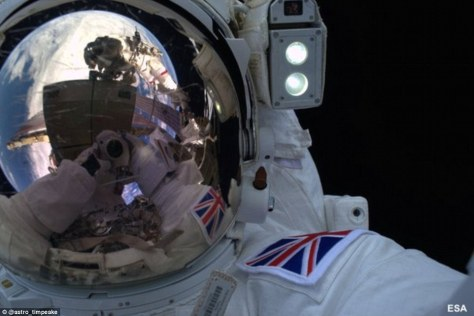 A selfie photograph taken by British astronaut Major Tim Peake of himself during his historic first space walk outside the International Space Station on 15 January 2016. The British Union flag is visible on the left shoulder of his pressure suit, as well as a view of the Earth being reflected in his visor.
