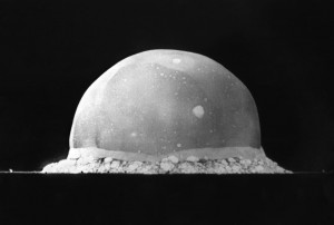 A black and white photograph of the Trinity test fireball at Los Alamos.