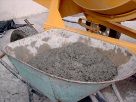 A photograph showing a wheelbarrow full of modern Portland cement.