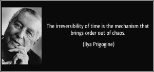 """A photograph of Belgian physicist Ilya Prigogine and quote by him saying: """"The irreversibility of time is the mechanism that brings order out of chaos""""."""