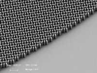 A close-up photograph of Capasso's metalens structure.