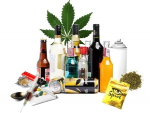 A photograph assembling some of the most common drugs of abuse, from alcohol and wine to cannabis and spice.