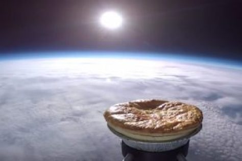 A photo-montage showing the meat and potato-filled pie that was sent up to the edge of the Earth's atmosphere, using a weather balloon. Source: SentInSpace