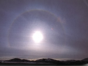 A photograph of a halo around the Sun, caused by cirrostratus clouds.