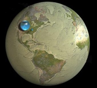 An illustration showing the relative sizes of the Earth, and the total volume of water, and safe-drinking water, available at its surface, as a small blue dot.