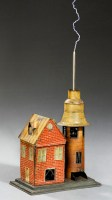 A photograph showing an antique scientific demonstration model of a house equipped with a lightning rod.