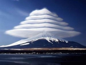 """A photograph of """"pile d'assiettes"""" (or pile of plates) clouds over the summit of Mount Fuji in Japan."""