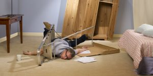 A man accidentally trapped inside a step-ladder while trying to put up a wardrobe.