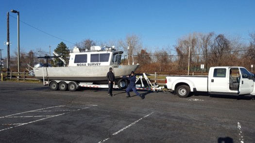NRT 5 boat S3007 on trailer, with Eli Smith and Lt. j.g. Dylan Kosten.