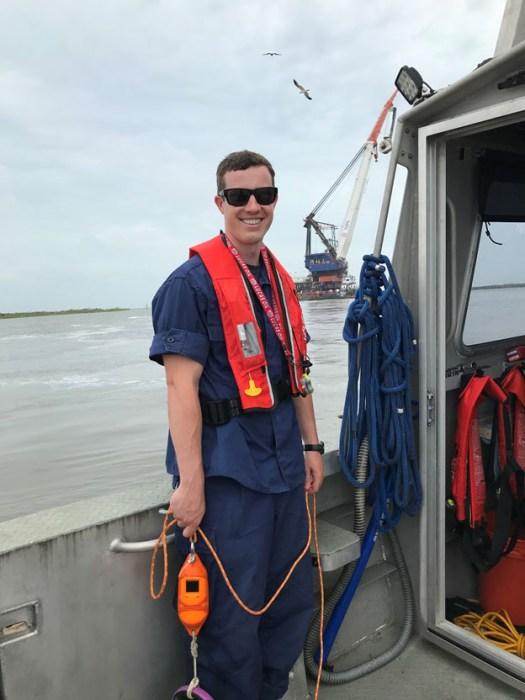 Lt. j.g. Patrick Lawler waits to take a cast off of survey vessel.