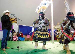 """Joe Tohonnie Jr., 34, was nominated for a Grammy in the best regional roots music album category on Dec. 6, 2014 for his """"Apache Blessings & Crown Dance Songs."""" In this photo, he performed during the 4th annual Monument Valley Balloon Event. (Times photo – Krista Allen)"""