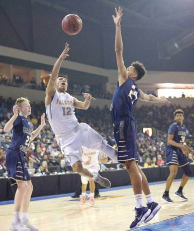 Navajo Times | Donovan Quintero Alchesay's Tyreck Cosay (12) leaps around a guarding Rancho Solano Prep Mustang player Saturday during the Arizona 2A boys championship game at the Prescott Valley Events Center in Prescott Valley, Ariz.