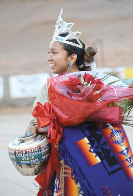 Navajo Times | Ravonelle Yazzie Newly crowned Miss Gallup Inter-Tribal Indian Ceremonial Ashley Claw, of Chinle, carries her gifts after being crowned by outgoing queen Zunneh-bah Martin on Aug. 11.