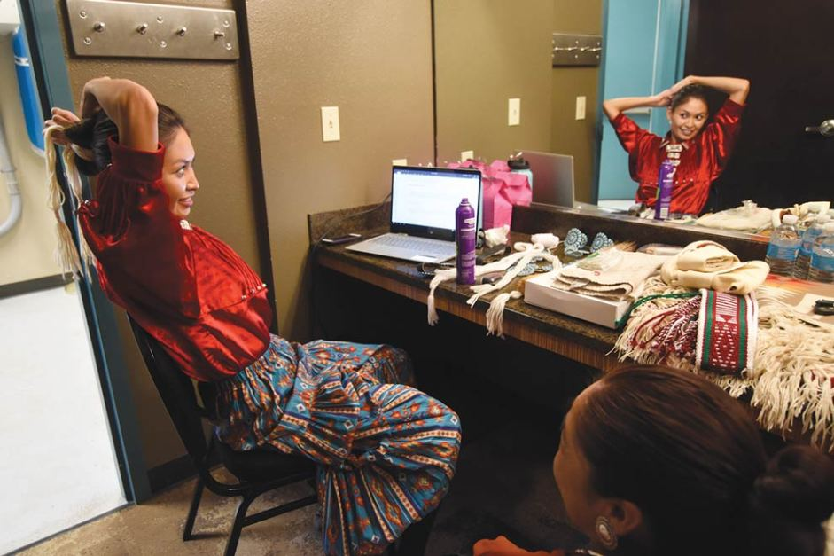 Navajo Times | Ravonelle Yazzie Contestant Sierra Vail fixes her tsiiyéél in the dressing room moments before the traditional talent presentations of the Miss Gallup Inter-Tribal Indian Ceremonial pageant.