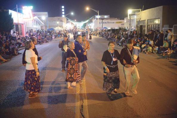 Navajo Times | Donovan Quintero A group of Gallup-McKinley County School District employees perform a two-step on Aug. 9 during the 97th annual Gallup Inter-Tribal Indian Ceremonial night parade in downtown Gallup. The group had no official group name.