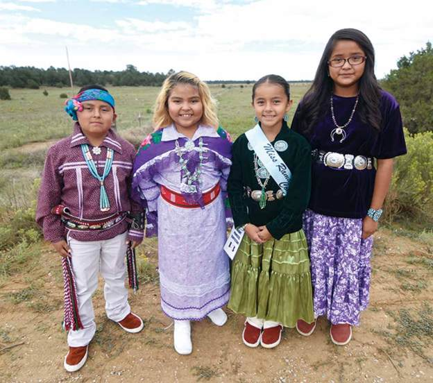 Navajo Times | Ravonelle Yazzie Left to right, Elias Longhat, Elisa Longhat, Geneva Nabours and Bryoni Nez wait for the parade to start at the Ramah Navajo Fair and Rodeo on Aug. 25.