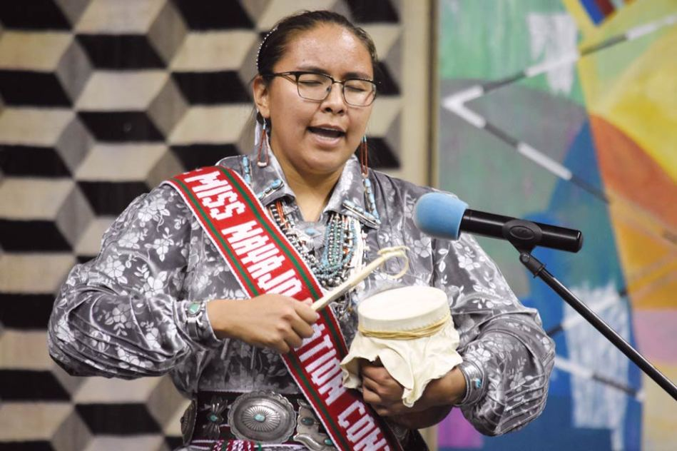 Navajo Times | Ravonelle Yazzie Summer Jake of Goat Springs, Ariz., a Miss Navajo contestant, sings a song written by her cheii at the traditional