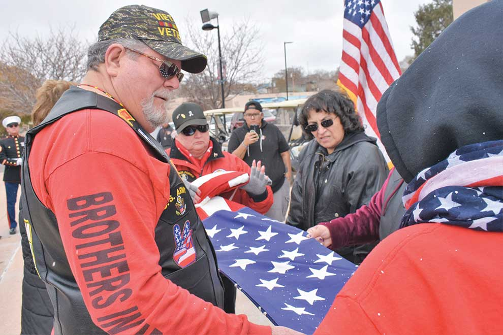 Navajo Times   Rima Krisst The folding of the American flag concludes the Veterans Day ceremonies in Gallup.