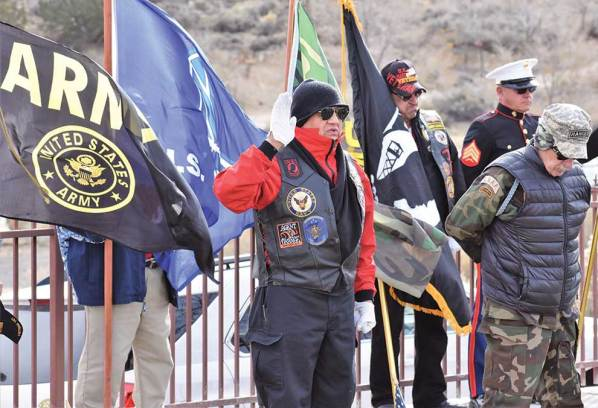 Navajo Times   Rima Krisst Tooley Brown leads the benediction at the Veterans Observance Ceremony at Hillcrest Cemetery in Gallup.