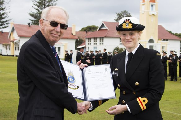 (L-R) Captain R. Bayley, RAN, (Retd) presents Lieutenant Rosamond Dwyer with the Naval Officers' Club Prize, for being the Reserve Entry Officers' Course member who displayed the best course results as well as self-discipline, resolution, undeviating application and good influence among her peers. *** Local Caption *** Graduates from New Entry Officer Course (NEOC) 52 celebrated the end of 20 weeks of intensive training at their 'Passing Out' Parade at HMAS Creswell. The new officers paraded as a guard on HMAS Creswell Quarterdeck and marched past the Reviewing Officer, Governor-General, His Excellency General the Honourable Sir Peter Cosgrove AK MC (Retd) At NEOC 52 graduation, the Royal Australian Navy observed 100 years of training excellence at HMAS Creswell. The first Cadet Midshipmen to undertake Officer initial entry training arrived at the base in 1915.