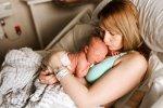 kissing newborn river after birth