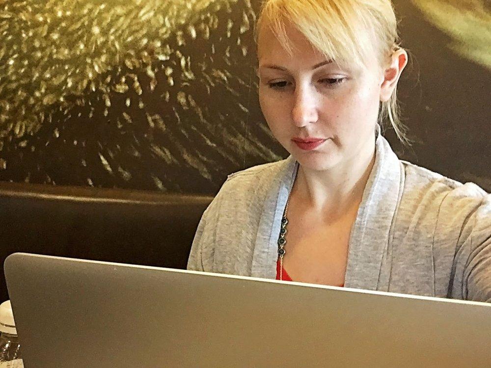 Shari looking down at laptop screen.