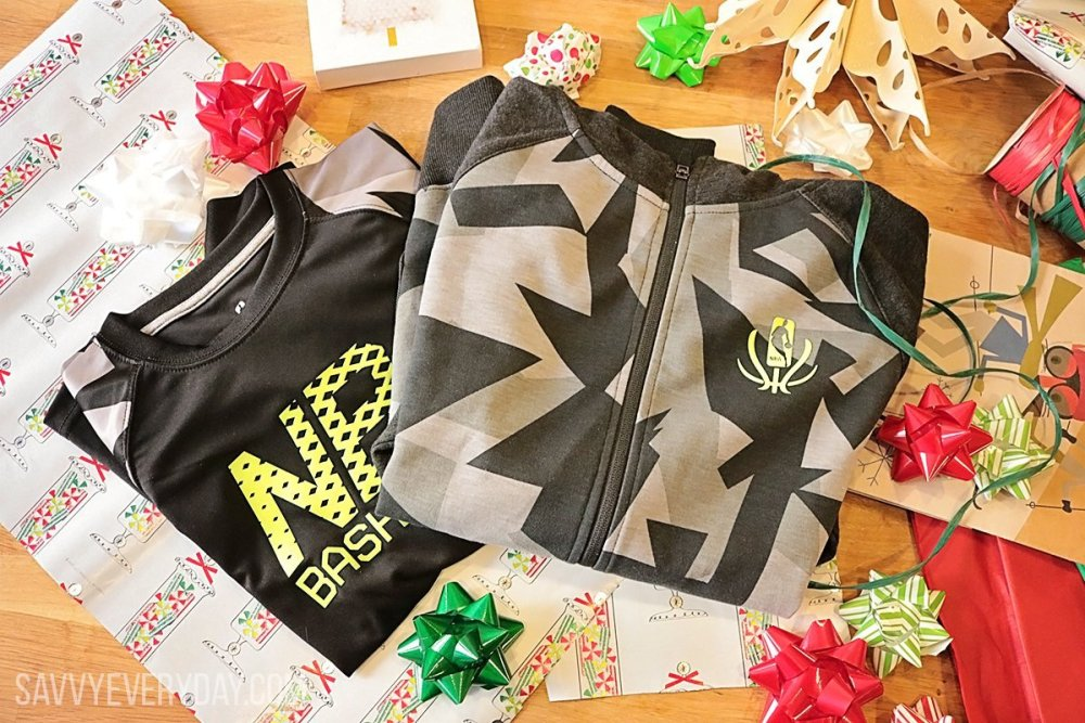 Photo of NBA Reflective jacket and shirt on a table with gift wrapping paper and bows