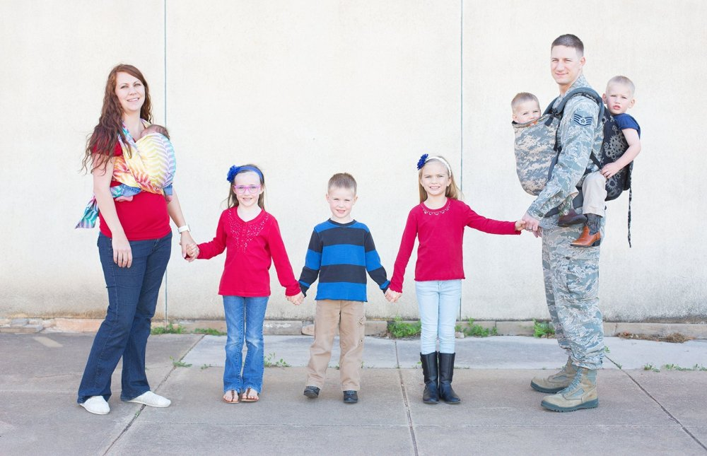 cute holding hands military family photo