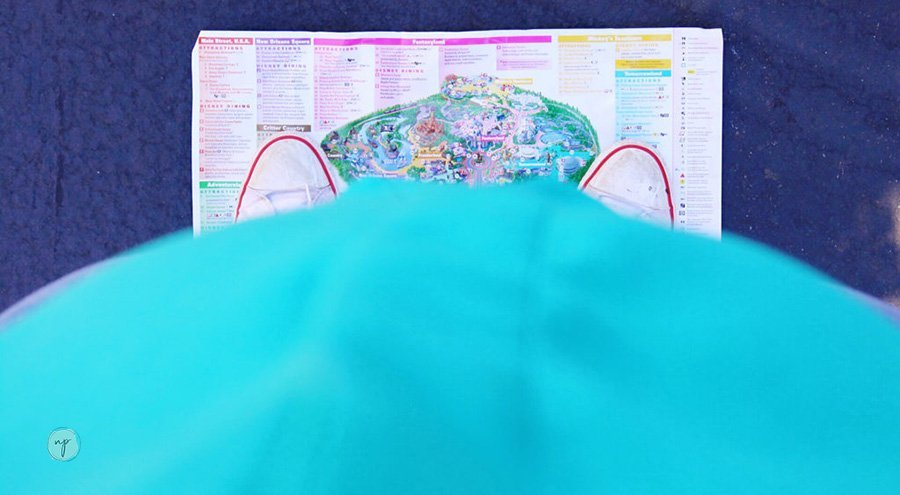 pregnant belly standing over Disneyland map