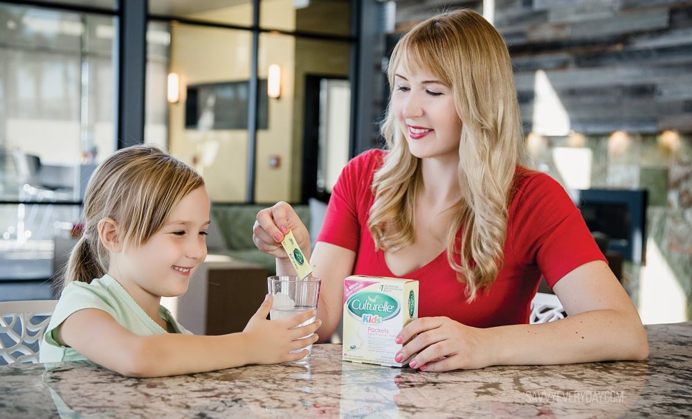smiling and pouring in culturelle probiotic