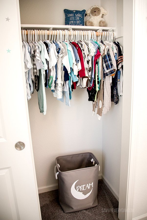 baby clothes and hamper