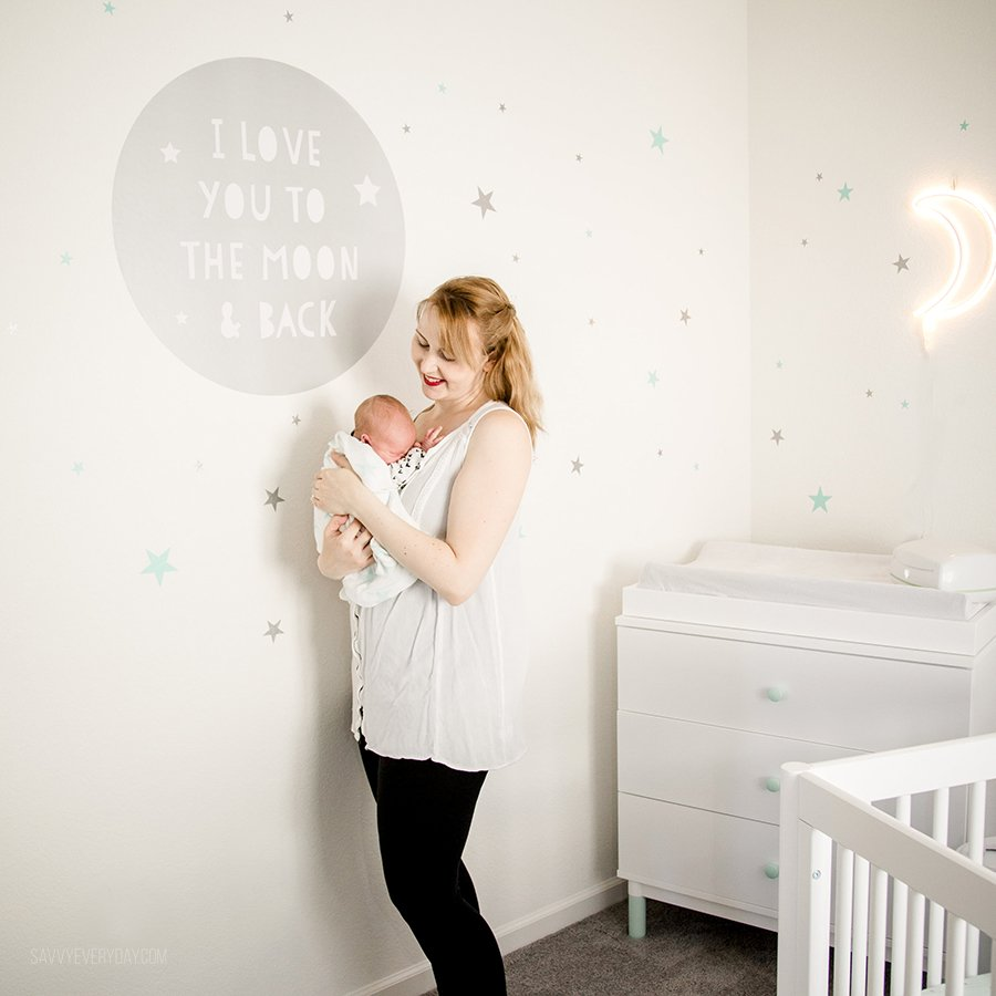 holding river next to wall decal