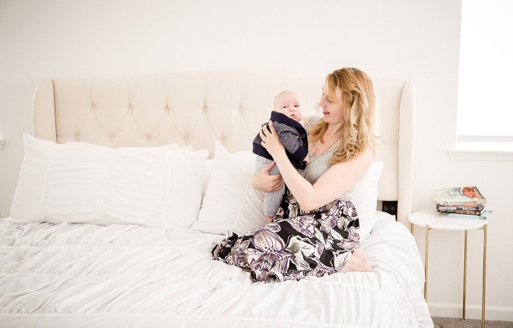 holding river in Pink Blush Maternity clothes
