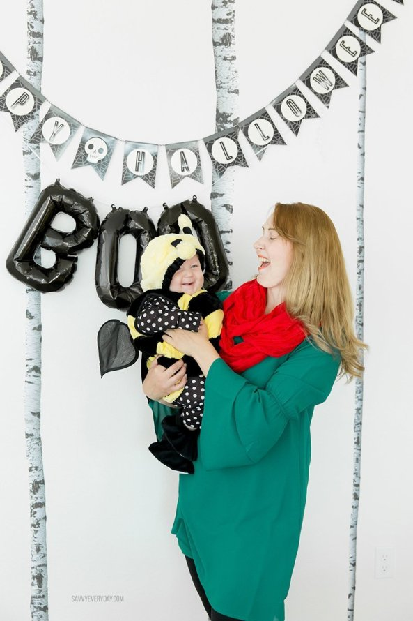 mom holding baby in bee costume