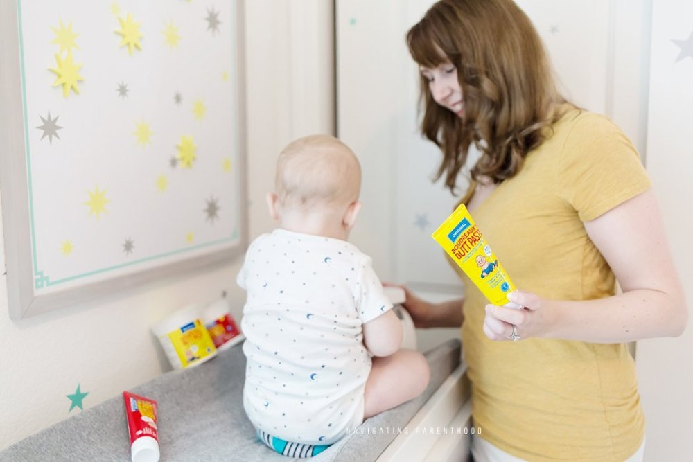 looking at baby on changing table_logo