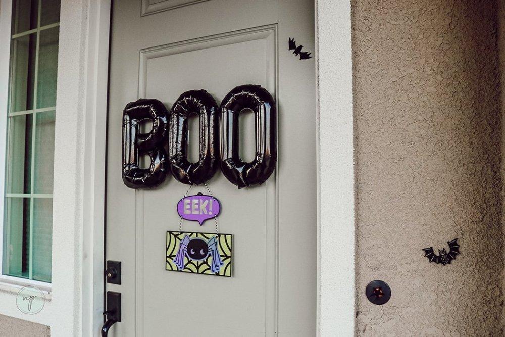 """Black Halloween """"BOO"""" balloon on door"""