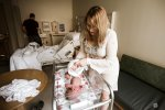 changing baby's clothes after delivery in the hospital after birth in postpartum